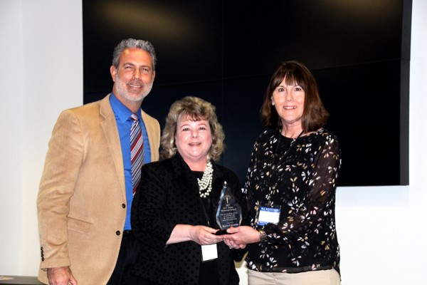 Left to right:  Matt Spade, Boyd County Public Schools District Administrator, Karen Curnutte, District Webmaster for Boyd County Schools receives the 2017 O.V. Jones  Memorial Award, and Linda Salyer the presenter of the award.